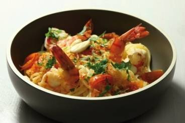 Spaghetti in a spicy sauce of prawns, cherry tomatoes and fresh coriander Recipe
