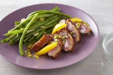 Glazed duck breast with passion fruit , orange and green beans