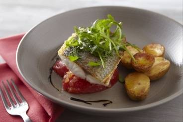 Crisp fillet of sea bass with tomatoes, basil, rocket and crushed new potato salad