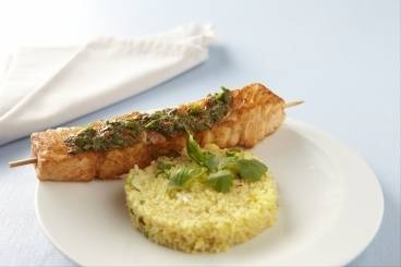 Salmon brochettes with saffron cous cous and cumin spiced salsa