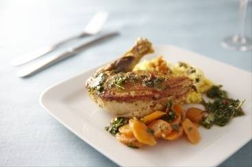 Moroccan spiced guinea fowl with cous cous royale, cumin carrots and a mint and coriander dressing