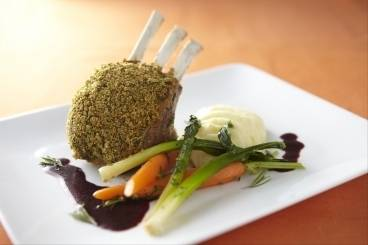Herb crusted rack of lamb with olive oil mash, buttered spring vegetables and red wine jus