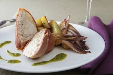 Pancetta wrapped guinea fowl with braised cicoria, salsa verde and rosemary roast new potatoes