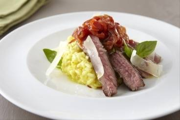 Lamb steak with risotto alla milanese and red pepper chutney