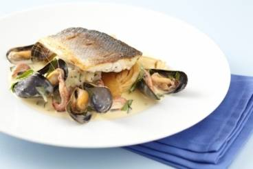 Crisp fillet of sea bass with roasted fennel, Dijonnaise potatoes and shellfish beurre blanc