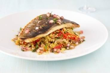 Crisp fillet of gilt head bream with saffron cous cous and pomegranate dressing Recipe