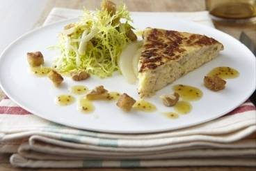 Goat's cheese and leek frittata with frisee, walnut and pear salad and garlic croutons