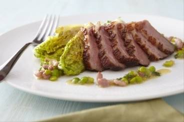 Roasted barbary duck breast with pommes puree and petit pois a la francaise