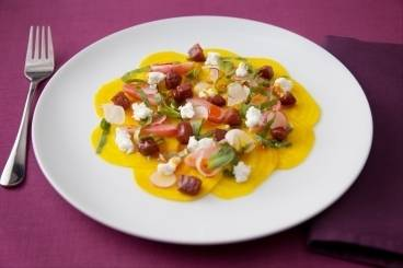 Carpaccio of candy beetroot, goats cheese and caramelised chorizo with braised radishes and sherry drizzle