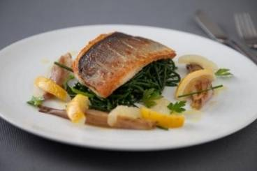 Sea bass with samphire, braised shallots and lemons