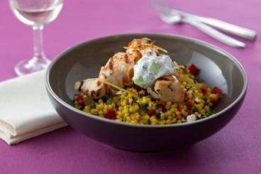 Chicken souvlaki with giant  cous cous and tzatziki