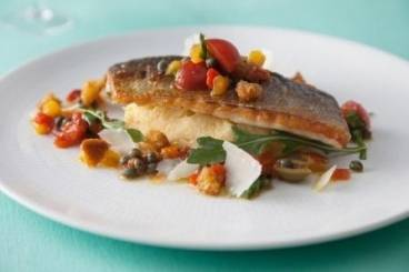 Crisp fillet of sea bass with polenta, rocket  and a panzanella dressing