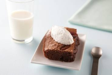 Gooey chocolate and pecan nut brownie with chantilly cream