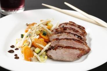 Glazed duck breast with stir fried vegetables