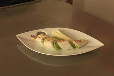 Stuffed squid with risotto and pesto