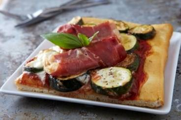 Pizza with grilled courgettes, garlic puree and parma ham