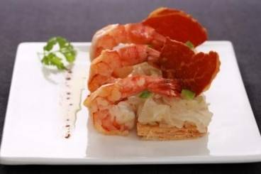 Grilled prawns and ham with a sweet onion and apple tart
