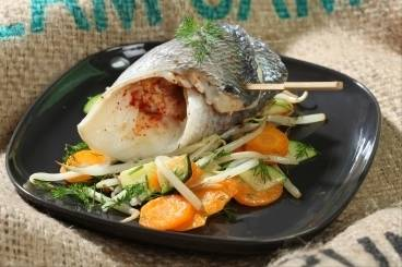 Sea bream with saffron oil served on a bed of carrots & courgettes with dill