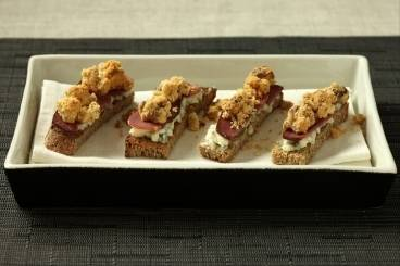 Roquefort and smoked duck breast toasts with a nut crumble topping
