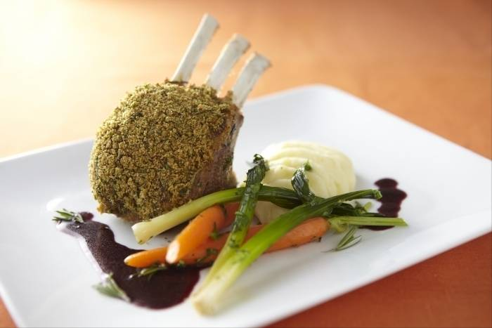 Herb crusted rack of lamb with olive oil mash, buttered spring vegetables and red wine jus Recipe