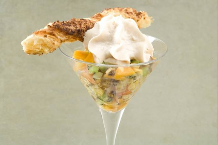 Tropical fruit salad with champagne emulsion and coconut twists Recipe