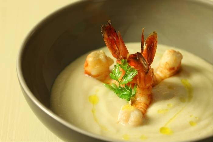 Jerusalem artichoke vélouté with pan-fried prawns Recipe